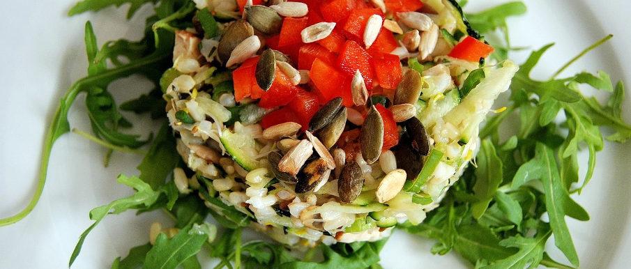 Riso rucola, pomodorini e semi di zucca